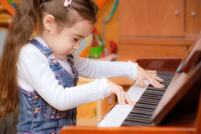 Little girl plays piano